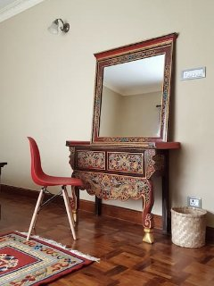 Handpainted dressing table with French designer Eames chair.