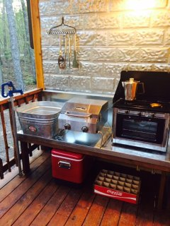cook a steak, bake a muffin, brew a pot of coffee, or wash up in the outdoor kitchen