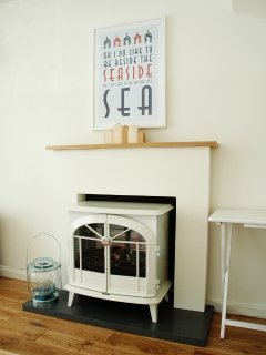 Beach House lounge with log stove electric fire