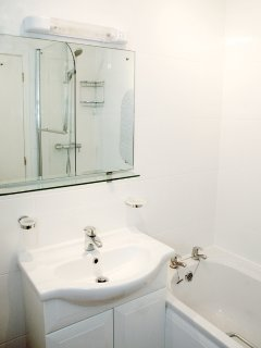 Bathroom with thermostatic shower and heated towel rail
