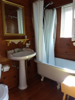 Attached master bath with claw foot tub