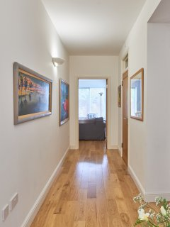 Spacious corridors in our all ground floor Severn apartment. Original paintings to enjoy.