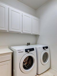COMPLETE LAUNDRY ROOM FOR OUR GUESTS TO UTILIZE WITH DEEP SOAKING SINK AS WELL FOR HAND-WASHING.