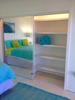 Built in wooden shelves in large closets.