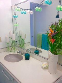 Clean and beachy bathroom.