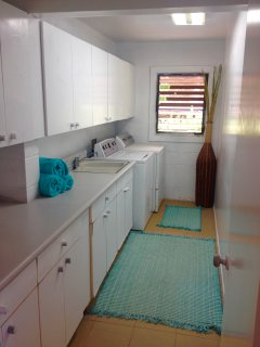 Laundry room w/sink, cabinets w/ dishes, glasses, pots/pans, utensils, spices, serving bowls, etc.