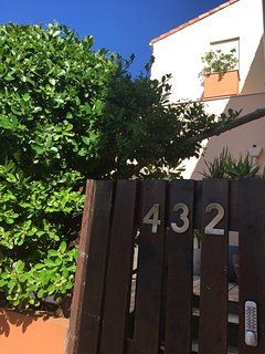 The outdoors of the apartment has a high hedge for your privacy.