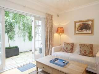 A large 2 bedroom flat in Kensington with a patio