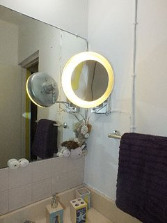 Lighted magnifying mirror for shaving or applying makeup