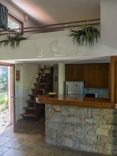 Kitchen and stairs to sleeping nook