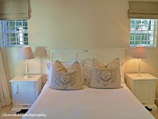 Main bedroom with 100 percent cotton percale linen looking onto the garden and the pool.
