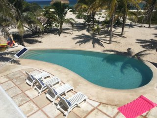 The large private beachfront property with laguna pool, WIFI and AC