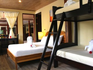 Bedroom 1: Queen size bed and traditional bunks with seating area and satellite tv.