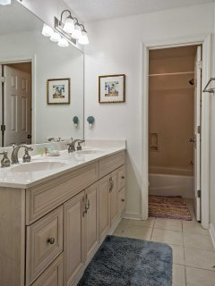 This en-suite bathroom offers spacious accommodations to clean up everyday.