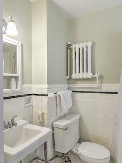 Wash off in the pristine bathroom.
