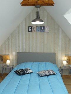 Une chambre au style marin à l'étage