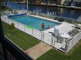 Gulf Access waterfront condo 1 BED ROOM 1 BATH. large pool, boat dock