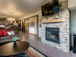 Gorgeous stone work surrounds the gas fireplace and flat screen TV