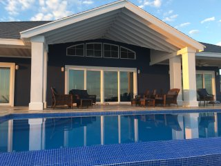 Most 5 Star Reviews! New Private Estate on Amazing beach, heated infinity pool!