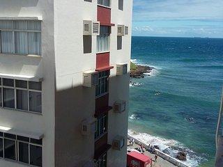 Quarto e sala frente mar