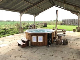 Our luxurious wood burning hot tub, which is free for guests to use during their stay