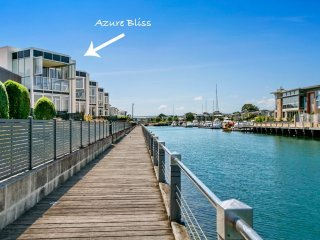 Azure Bliss - Luxury on the water, pool access, water views, WiFi, large deck, w