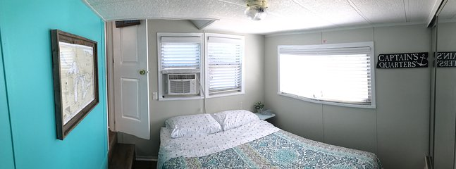 The Captains Quarters, master bedroom with a queen bed.  Linens provided!