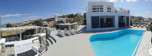 Luxury modern spacious villa overlooking Mykonos with pool & jacuzzi tub can accomodate 14 persons