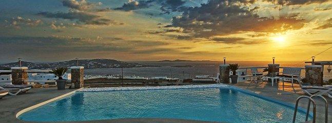 The famous Mykonos sunset everyday on Mykonos' blue horizon