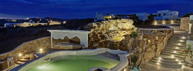 The jacuzzi hot/cold tub with the small pool and water therapy at night
