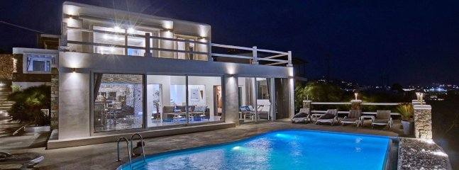 The villa & the pool with night lights.