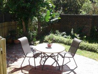 Garden with barbecue, seating. Enclosed and private.