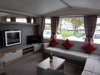 The Fox's Retreat Lounge with comfortable seating, feature fire, smart TV, & pull out sofa bed