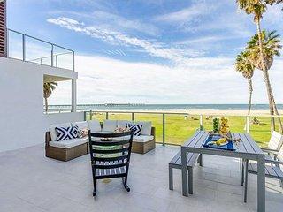 Modern, beachfront condo, spectacular ocean views, steps to shops & dining!