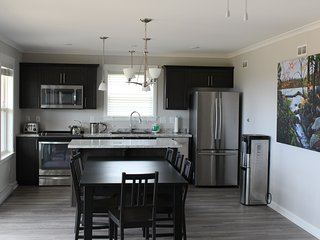 Fully equipped kitchen and dining with ocean view