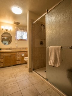 new bathroom with tile and walk in shower