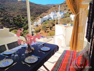 Traditional Cycladic house with character in an authentic hamlet near the sea