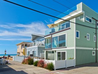 2 homes off the beach - 3 stories and roof deck