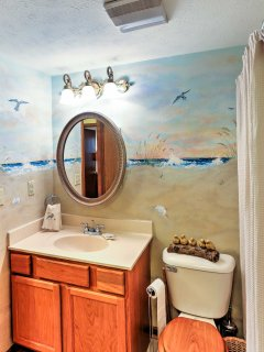 The full bathroom is stocked with fresh towels for your comfort.
