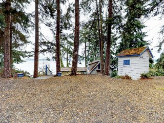 Peaceful bayfront home featuring views of Puget Sound & forest surroundings!