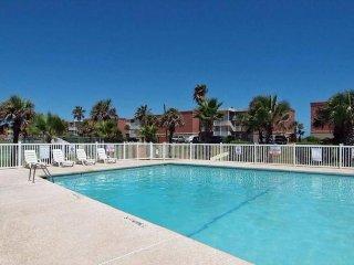 Cute poolside condo w/ private patio, shared pool, partial ocean views!