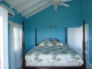Four posted king-size bed in master bedroom