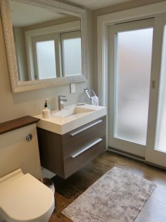 There is a powder room on the first floor and that door leads to a wonderful outdoor shower.