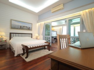 Upper level Ensuite with King-size bed, dressing area and bath.