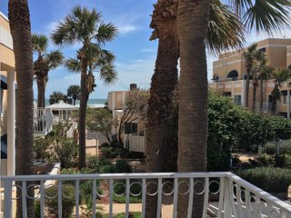 Pristine condo with shared pool, hot tub, and balcony with partial ocean view