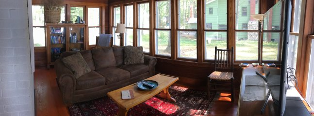 sun room with lake side view.  Includes pull out couch and cable tv(48 inch)