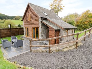 YR HEN EFAIL, barn conversion, exposed wooden beams and stone, countryside views