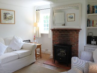 The sitting room has an electric 'woodburner' and an open fireplace behind