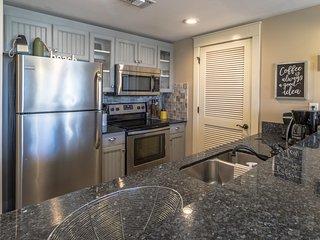 Kitchen.  Washer/Dryer behind vented door