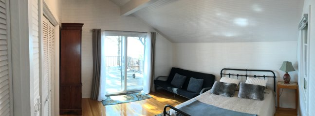 1st floor bdr, lake view and deck access. Queen bed, futon, closet and dresser